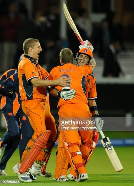 Netherlands batsmen Ryan ten Doeschate and Edgar Schiferli celebrate with Daan van Bunge after Netherlands win the ICC World Twenty20 group match...