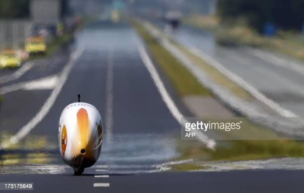 Netherlands' biker Sebastiaan Bowier take part in a bike speed record attempt event with his aerodynamic bike Velox3 on the A31 highway between the...