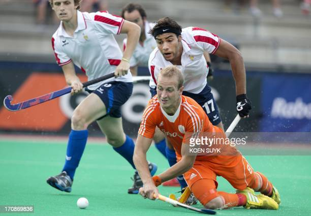 Netherland's Billy Bakker vies with French player Lucas Sevestre during the match between The Netherlands and France at the Hockey World League in...