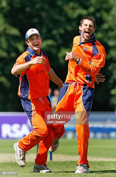 Netherland's bowler Pieter Seelarr celebrates with Peter Borren after bowling out Kenya's Steve Tikolo during the Kenya and Netherlands ICC World...