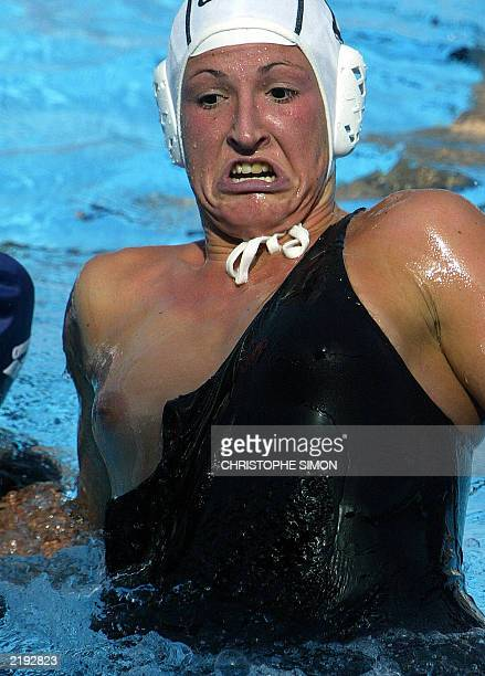 Netherlands' Carla Quint jumps out of the water in Barcelona 21 July 2003 during a 10th FINA Water polo World Championships women's quarterfinal...