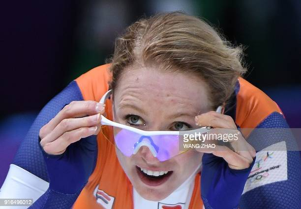 Netherlands' Carlijn Achtereekte celebrates her win in the women's 3,000m speed skating event during the Pyeongchang 2018 Winter Olympic Games at the...