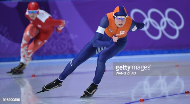 Netherlands' Carlijn Achtereekte leads Poland's Karolina Bosiek in the women's 3000m speed skating event during the Pyeongchang 2018 Winter Olympic...
