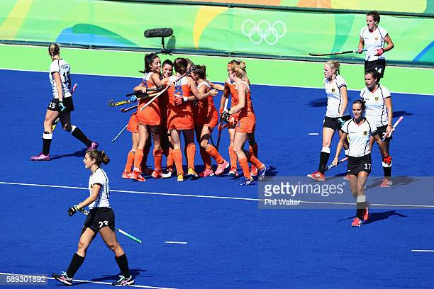 Netherlands celebrate their second goal in their Women's Pool A Match against Germany on Day 8 of the Rio 2016 Olympic Games at the Olympic Hockey...