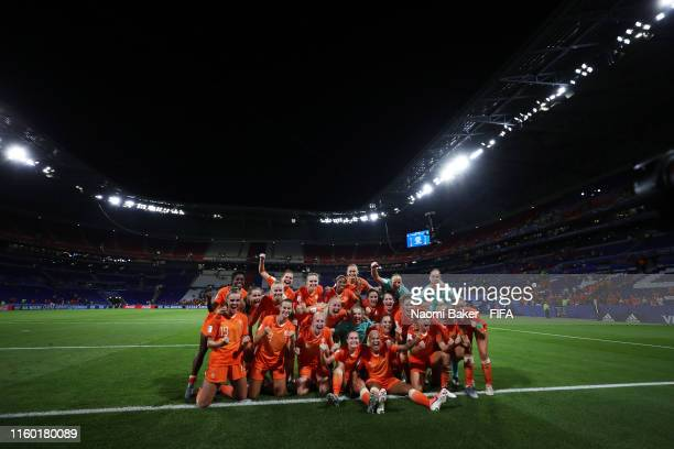 Netherlands celebrate towards the fans after their teams victory in the 2019 FIFA Women's World Cup France Semi Final match between Netherlands and...