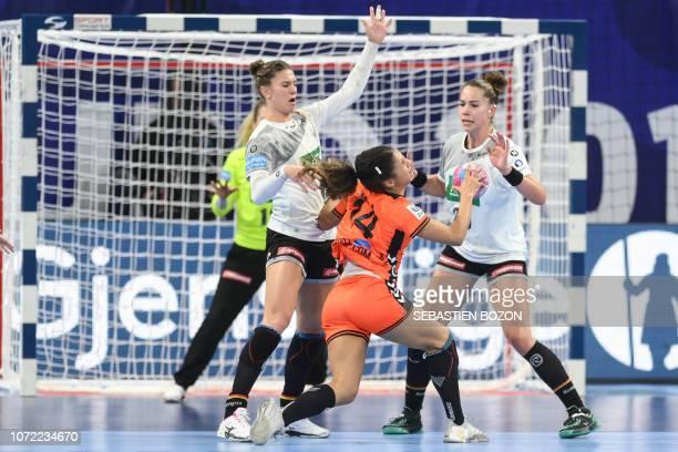 Netherlands' center back Delaila Amega vies with Germany's pivot Julia Behnke and Germany's left back Emily Bolk during the 2018 European Women's...