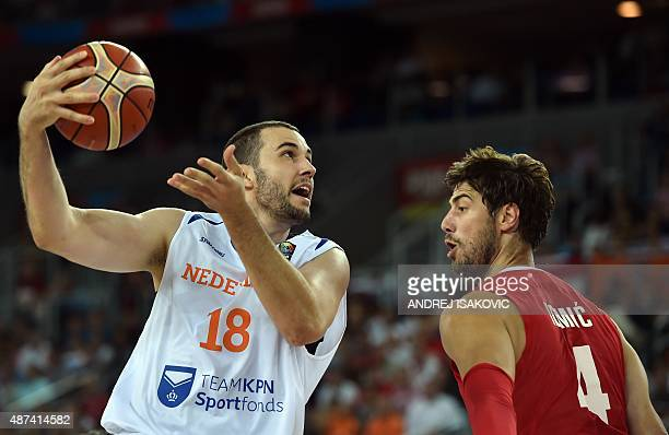 Netherlands' center Nicolas De Jong vies with Croatia's center Ante Tomic during the Group C qualification basketball match between Netherlands and...