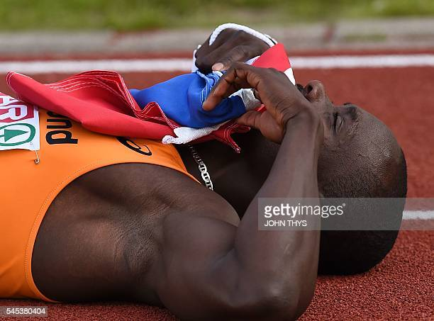 Netherlands' Churandy Martina reacts after winning the men's 100 m final race during the European Athletics Championships in Amsterdam at the Olympic...