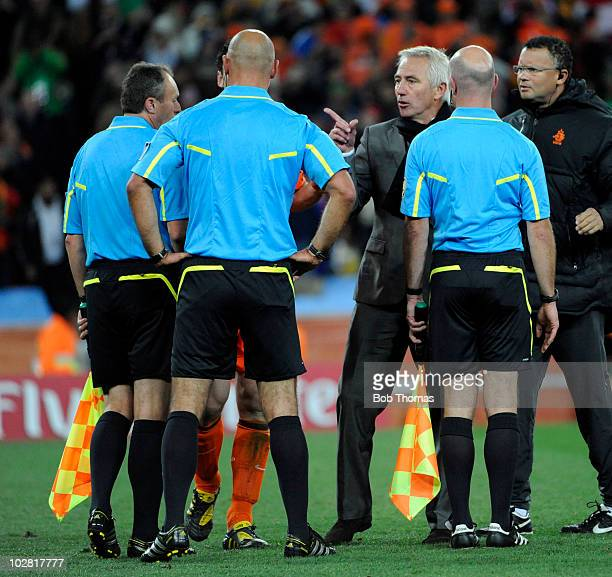 Netherlands coach Bert Van Marwijk makes a point to referee Howard Webb after the 2010 FIFA World Cup Final between the Netherlands and Spain on July...