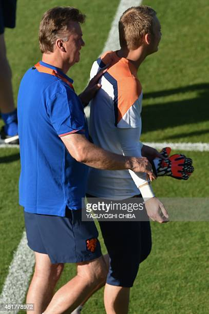 Netherlands' coach Luis van Gaal speaks with Jasper Cillessen during a training session at the Flamengo FC stadium in Rio de Janeiro on July 6 2014...