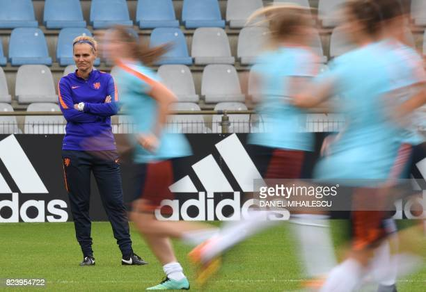 Netherlands' coach Sarina Wiegman looks on as her players take part in a training session at Stadion De Vijverbeg in Doetinchem on July 28 on the eve...