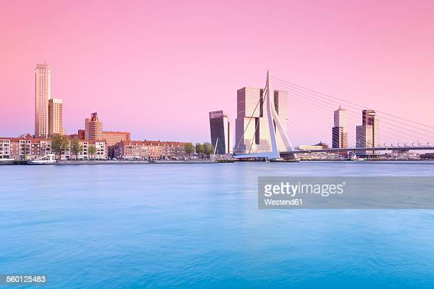 Netherlands, County of Holland, Rotterdam, View to Erasmus bridge and the skyline in the evening
