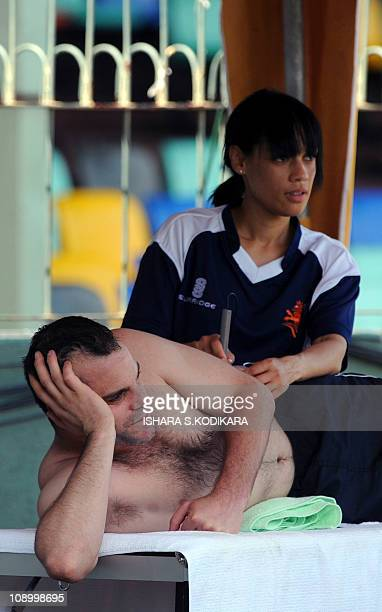 Netherlands cricket team captain Peter Borren is treated by a team physician during a training session at the Sinhalese Sports Club Cricket Ground in...