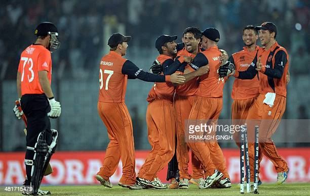 Netherlands cricketers celebrate their victory over England during the ICC World Twenty20 tournament cricket match between Netherlands and England at...