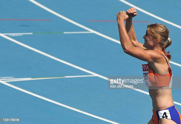 Netherland's Dafne Schippers celebrates after winning her women's 200 metres heat at the International Association of Athletics Federations World...