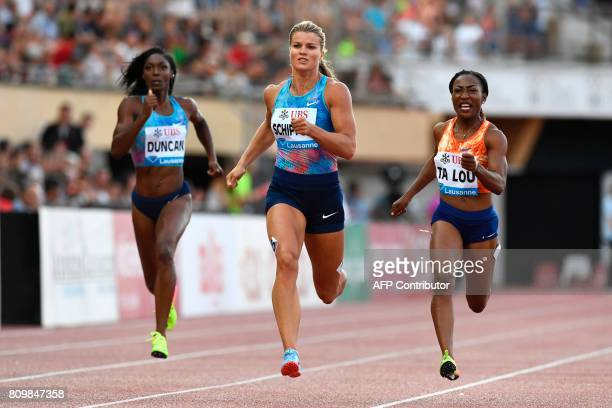 TOPSHOT Netherlands' Dafne Schippers competes to win the women's 200m ahead of Ivory Coast's MarieJosee Ta Lou during the Diamond League athletics...