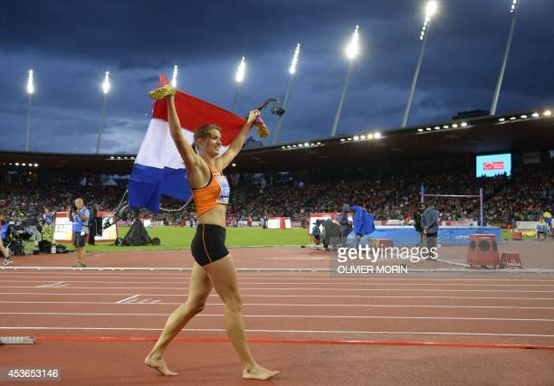 Netherlands' Dafne Schippers holding her national flag celebrates after winning the Women's 200m final during the European Athletics Championships at...
