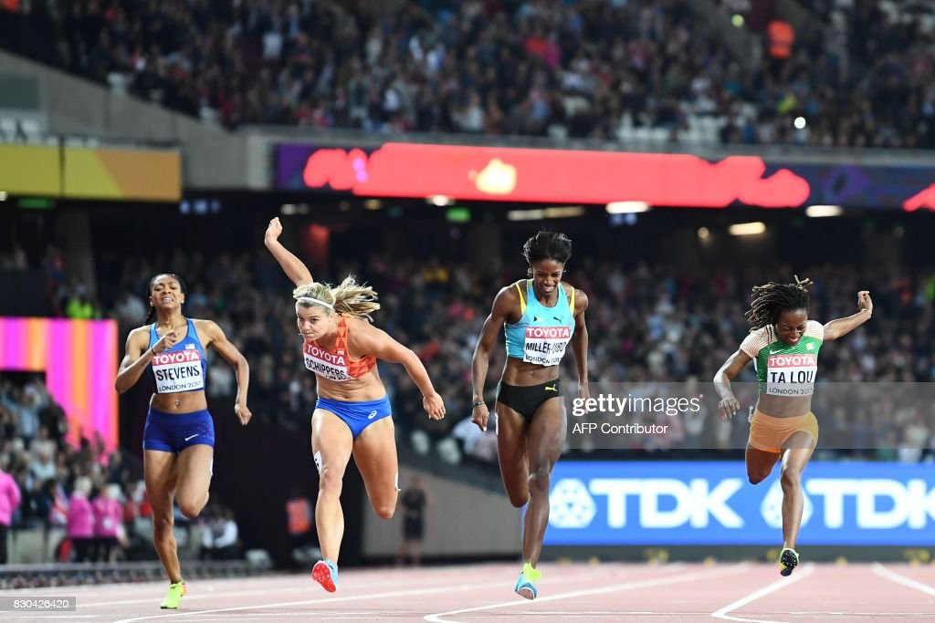 Netherlands' Dafne Schippers (2L) wins the final ahead of Ivory Coast's Marie-Josée Ta Lou (R) and Bahamas's Shaunae Miller-Uibo of the women's 200m athletics event at the 2017 IAAF World Championships at the London Stadium in London on August 11, 2017. / AFP PHOTO / Jewel SAMAD