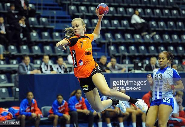 Netherlands' Debbie Bont throws the ball past Dominican Republic's Crisleydi Hernandez during the Women's Handball World Championship 2013 match...