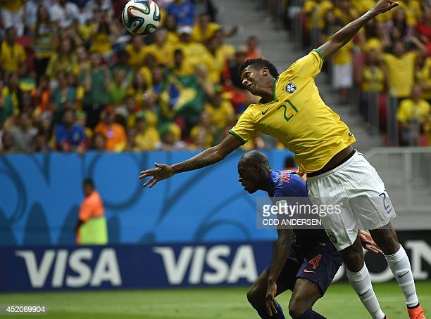 Netherlands' defender Bruno Martins Indi and Brazil's forward Jo vie during the third place playoff football match between Brazil and Netherlands...