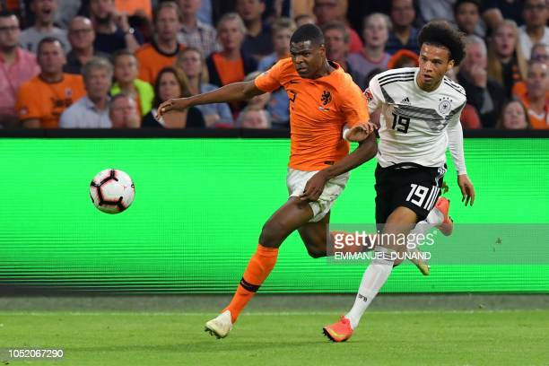 Netherland's defender Denzel Dumfries vies with Germany's midfielder Leroy Sane during the UEFA Nations League football match between Netherlands and...