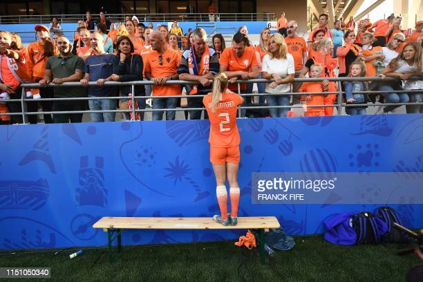 TOPSHOT Netherlands' defender Desiree van Lunteren celebrates with supporters after the France 2019 Women's World Cup Group E football match between...