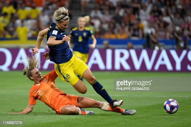 Netherlands' defender Desiree van Lunteren vies for the ball with Sweden's defender Nilla Fischer during the France 2019 Women's World Cup semi-final...