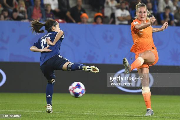 Netherlands' defender Desiree van Lunteren vies with Japan's midfielder Yui Hasegawa during the France 2019 Women's World Cup round of sixteen...