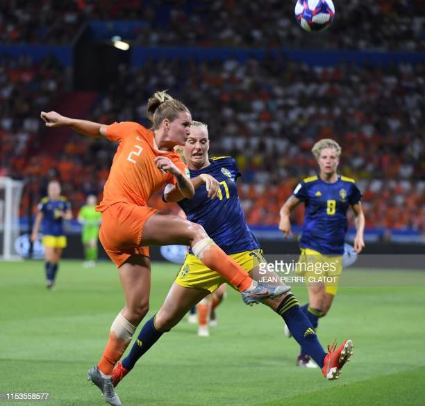 Netherlands' defender Desiree van Lunteren vies with Sweden's forward Stina Blackstenius during the France 2019 Women's World Cup semi-final football...