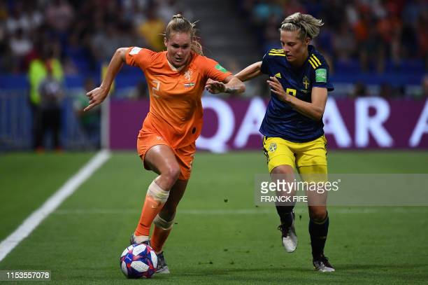Netherlands' defender Desiree van Lunteren vies with Sweden's midfielder Lina Hurtig during the France 2019 Women's World Cup semi-final football...