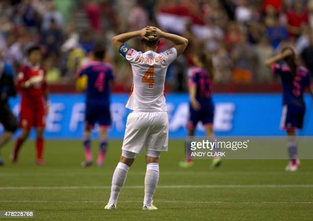 Netherlands defender Mandy van den Berg reacts after losing during their round of 16 football match against Japan at BC Place Stadium in Vancouver...