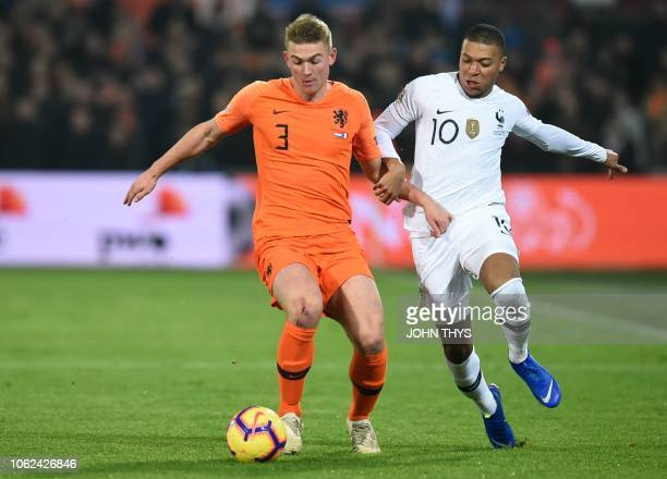 Netherlands' defender Matthijs De Ligt vies for the ball with France's forward Kylian Mbappe during the UEFA Nations League football match between...