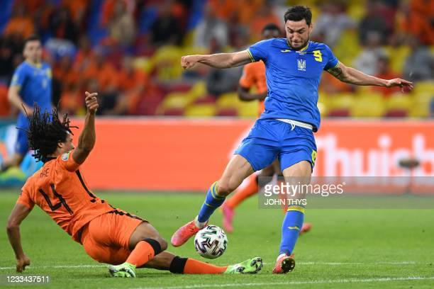 Netherlands' defender Nathan Ake attempts a tackle on Ukraine's forward Roman Yaremchuk during the UEFA EURO 2020 Group C football match between the...
