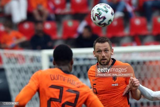 Netherlands' defender Stefan de Vrij eyes the ball during the friendly football match between Netherlands and Georgia at De Grolsch Veste Stadium in...