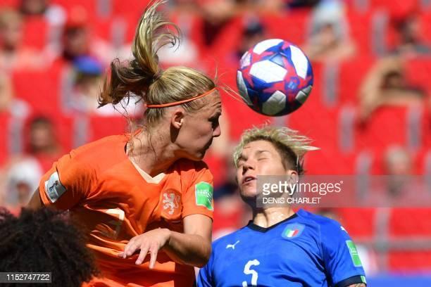 TOPSHOT Netherlands' defender Stefanie van der Gragt heads the ball to score a goal during the France 2019 Women's World Cup quarterfinal football...