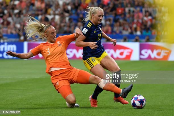 Netherlands' defender Stefanie van der Gragt vies for the ball with Sweden's forward Stina Blackstenius during the France 2019 Women's World Cup...