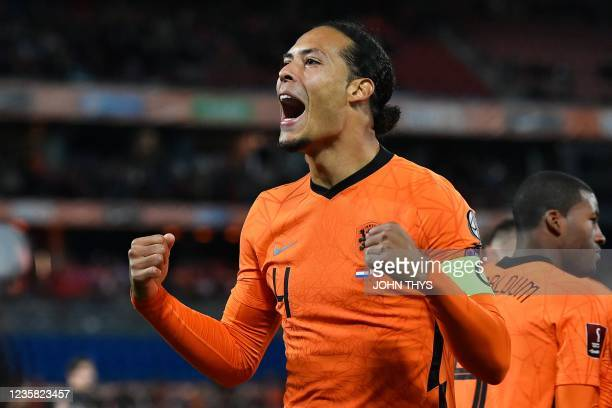 Netherlands' defender Virgil van Dijk celebrates scoring his team's first goal during the FIFA World Cup Qatar 2022 qualification group G football...