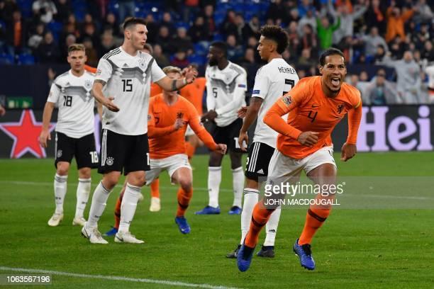 Netherlands' defender Virgil van Dijk celebrates scoring the 22 during the UEFA Nations League football match Germany v the Netherlands in...