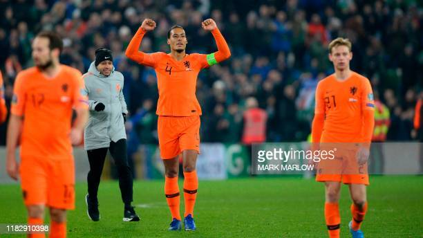 Netherlands' defender Virgil van Dijk celebrates their qualification for the finals on the pitch after the Euro 2020 qualification football match...