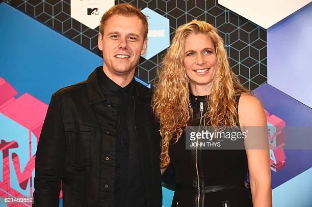 Netherlands' DJ Armin van Buuren and wife Erika van Thiel pose at the MTV Europe Music Awards on November 6, 2016 at the Ahoy Rotterdam in Rotterdam....