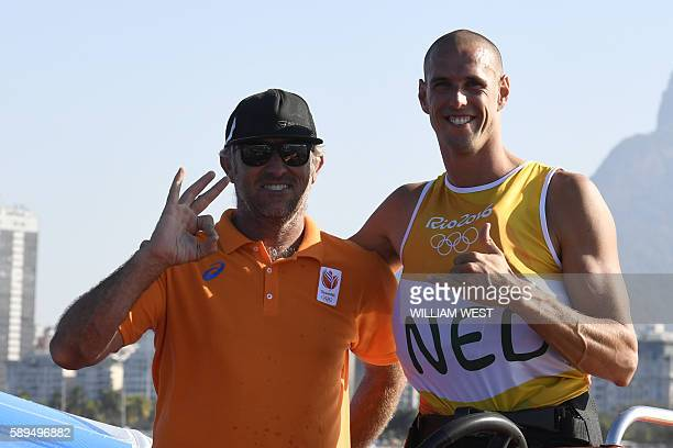 Netherlands' Dorian Van Rijsselberghe celebrates after he won the RSX Men sailing final race on Guanabara Bay in Rio de Janerio during the Rio 2016...