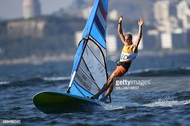 TOPSHOT Netherlands' Dorian Van Rijsselberghe celebrates after winning the RSX Men sailing final race on Guanabara Bay in Rio de Janerio during the...