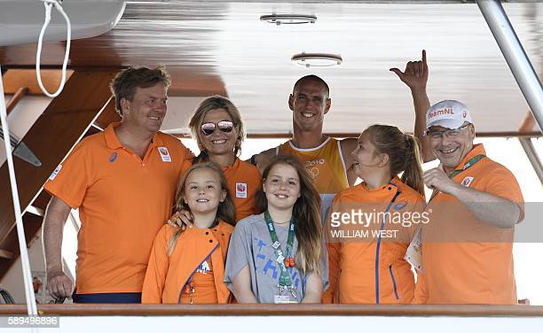 TOPSHOT Netherlands' Dorian Van Rijsselberghe poses with Netherland's King WillemAlexander Queen Maxima and their daughters Catharina Alexia Ariane...