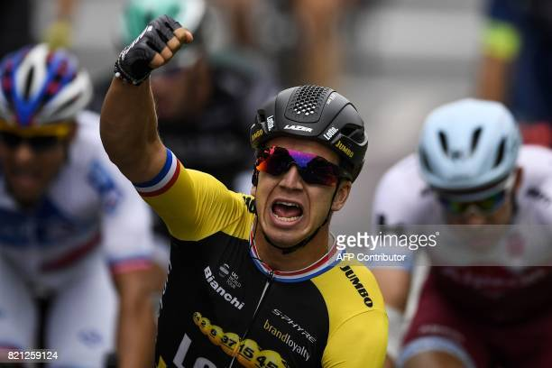 Netherlands' Dylan Groenewegen celebrates as he crosses the finish line to win at the end of the 103 km twentyfirst and last stage of the 104th...