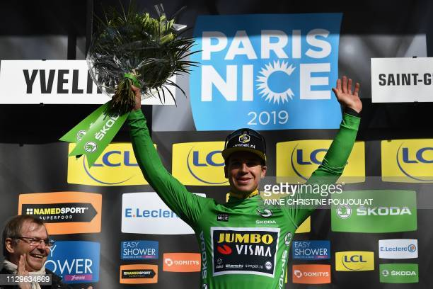Netherlands' Dylan Groenewegen celebrates his green jersey of best sprinter on the podium at the end of the 1385km 1st stage of the 77th ParisNice...