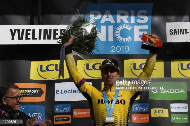 Netherlands' Dylan Groenewegen celebrates his overall leader's yellow jersey on the podium at the end of the the 1385km 1st stage of the 77th...