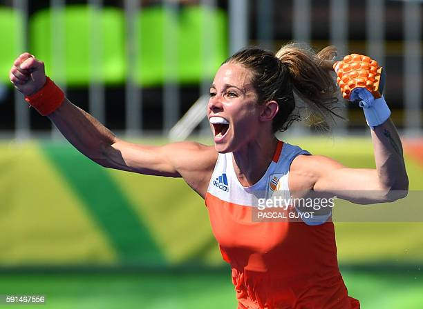 Netherlands' Ellen Hoog celebrates her goal during the penalty shootout at the end of the the women's semifinal field hockey Netherlands vs Germany...