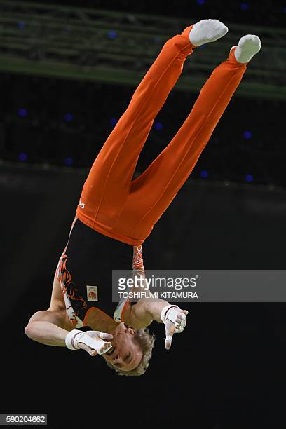 Netherlands' Epke Zonderland competes in the men's Horizontal bar event final of the Artistic Gymnastics at the Olympic Arena during the Rio 2016...