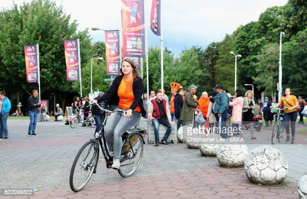 Netherlands fan arrive on their bikes during the UEFA Women's Euro 2017 Group A match between Belgium and Netherlands at Koning Willem II Stadium on...