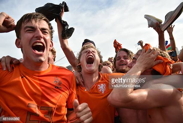 Netherlands' fans celebrate at they watch the Round of 16 football match between Mexico and the Netherlands at Fanfesta's live projection at...